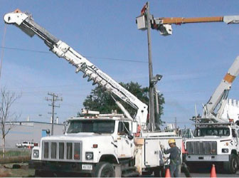 Boom Trucks Performing 24 Hour Emergency Power Services